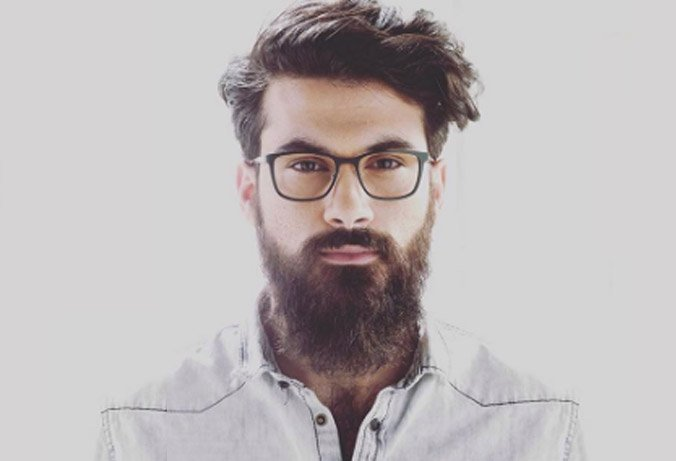 man with long beard wearing round acetate Face a Face optical frame