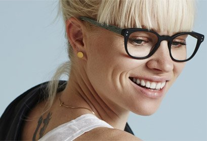 blond woman wearing bold black Prodesign Denmark eyeglasses
