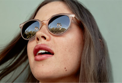 Woman wearing Garrett Leight Sunglass