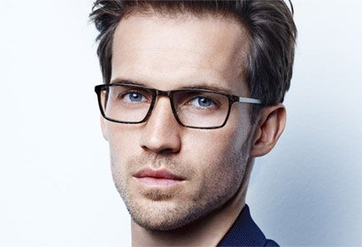 man wearing Lindberg Acetanium rectangular frame with titanium arms