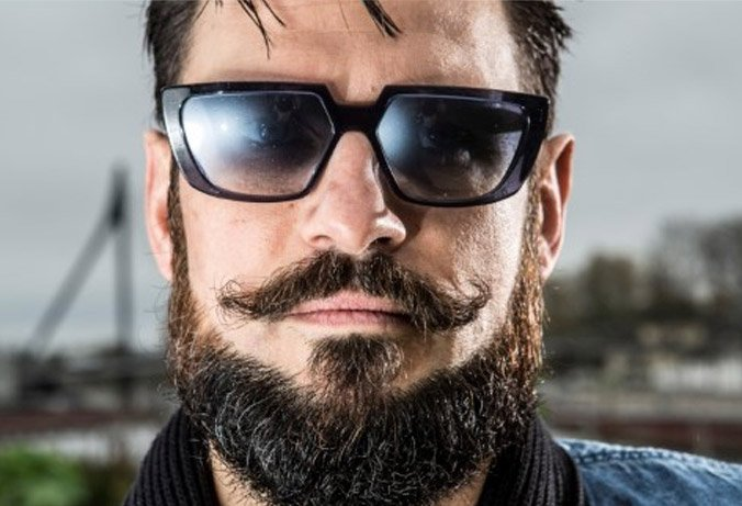 bearded man wearing black Henau sunglasses