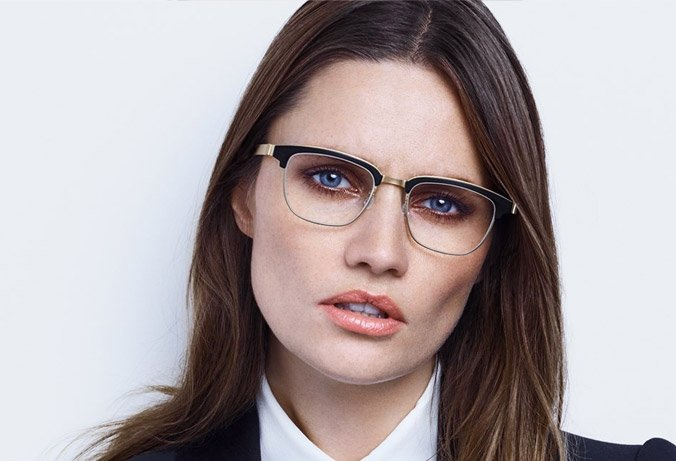 long dark hair woman wearing lindberg strip eyewear acetate across brow