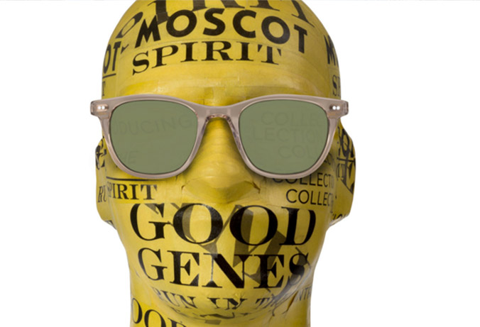 Moscot Sunglasses on polystyrene head covered in yellow Moscot paper