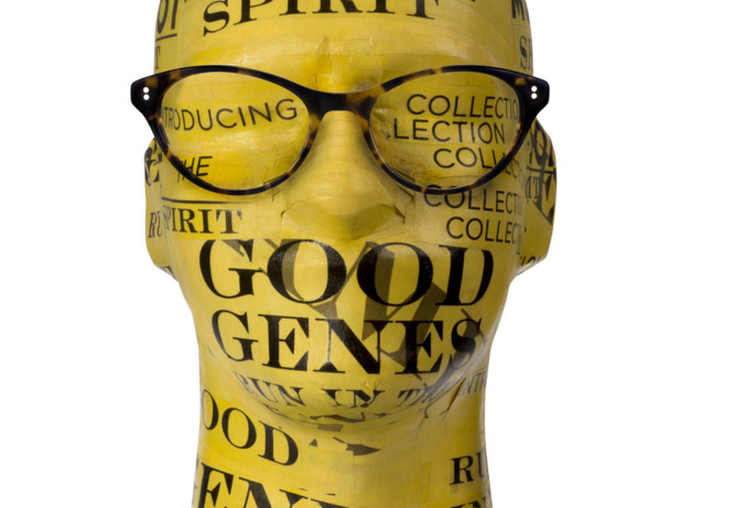 Moscot optical acetate frame on polystyrene head covered in yellow Moscot branded paper
