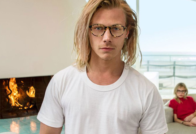 guy with long blond surfy look wearing Oliver Peoples optical
