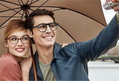 woman and man under umbrella smiling wearing Face a Face eyewear